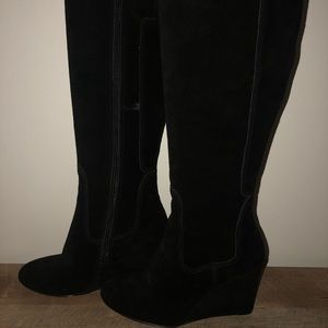 Tall black boots with wedges